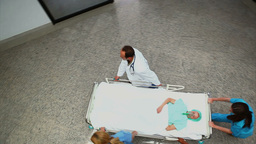 High angle view of a medical team pushing a patien Stock Video Footage