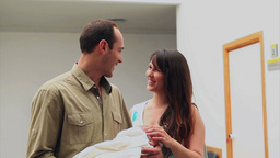 Happy woman and man with their newborn baby Stock Video Footage