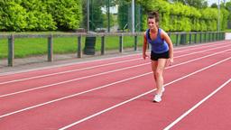 Women running relay race Footage