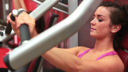 Woman training at weights machine Stock Video Footage