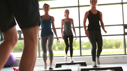 Trainer with his female aerobic group Footage