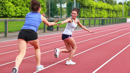 Two women in relay race Footage