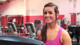 Smiling woman running on treadmill Stock Video Footage