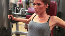 Woman using weights machine Stock Video Footage