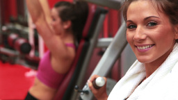 Woman using weights machine and smiling Stock Video Footage