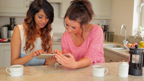 Women using tablet computer Stock Video Footage
