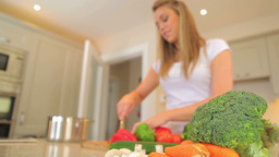 Woman chopping vegetables Footage