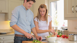 Couple is preparing salad together Footage