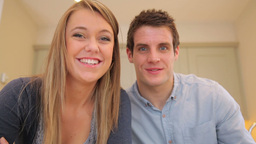 Couple talking and laughing to video chat Stock Video Footage