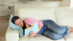 Pregnant woman enjoying reading a book Footage