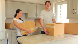Couple proudly put moving boxes in the kitchen Footage