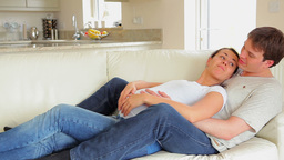 Pregnant woman relaxing with husband Stock Video Footage