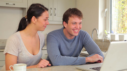 Couple waving and talking to video chat Footage