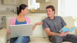 Man giving wife credit card for online shopping Footage