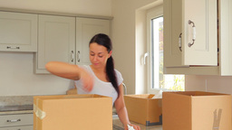 Woman unpacking after move Stock Video Footage
