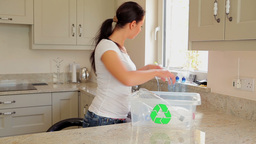 Woman recycling plastic bottles Footage