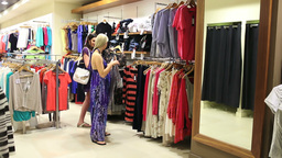 Woman looking in the mirror in a shop Stock Video Footage
