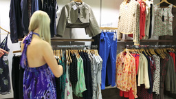 Women friends looking through clothes Stock Video Footage