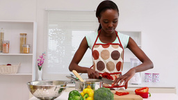 Woman chopping vegetables in kitchen Footage
