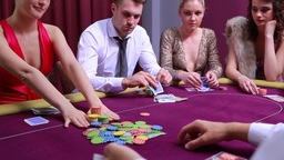 Woman going all in and other people at table foldi Footage