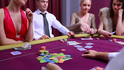 Woman going all in and other people at table foldi Stock Video Footage