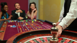 Dealer spinning the roulette wheel Footage
