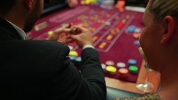 Woman talking to man at roulette table Stock Video Footage