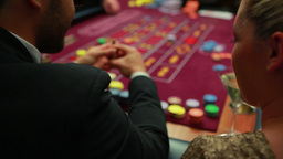 Woman talking to man at roulette table Footage
