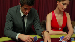 Woman cheating at poker table Live Action