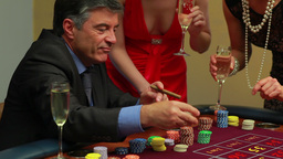 Man smoking a cigar wins at roulette Stock Video Footage