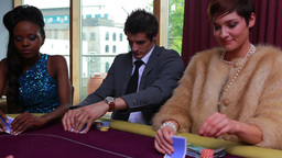 People being dealt poker cards with two people folding and one placing bet Live Action