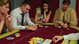 Four people playing poker and one is folding Footage