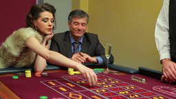 Woman and man placing bets on roulette table Footage