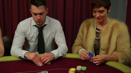 Man and woman only people left in poker game and w Stock Video Footage