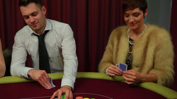 Man and woman only people left in poker game and w Footage