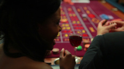 Woman talking to man while playing roulette Stock Video Footage