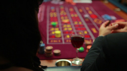 Woman talking to man while playing roulette Footage