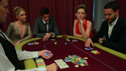 Four people playing poker and one going all in Footage