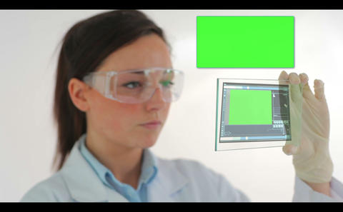 Scientist in protective clothes watching holographic chroma keys Animation