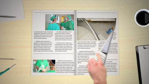 Hand turning pages of medical news magazines Animation