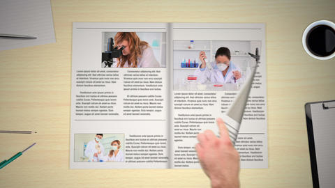 Hand turning pages of medical newspaper Animation