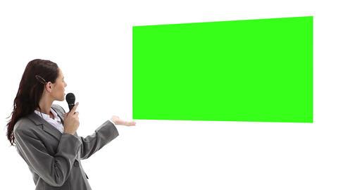 Woman presenting chroma key Stock Video Footage