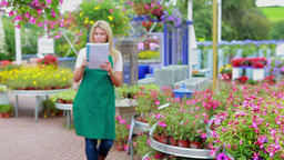 Garden center worker with notepad Stock Video Footage