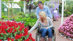 Couple looking at flowers at the garden centre Footage