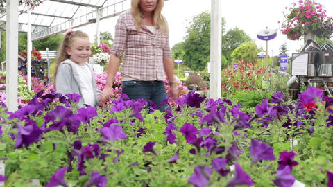 Mother and child standing at the garden centre Stock Video Footage