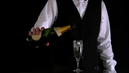 Waiter topping up champagne flute Stock Video Footage