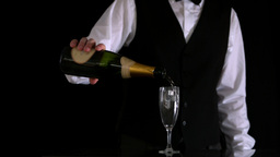 Waiter topping up champagne flute Footage