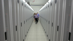Three technicians walking down the hallway Stock Video Footage