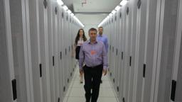 Three technicians walking down the hallway Footage