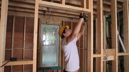 Builder hammering door frame Stock Video Footage